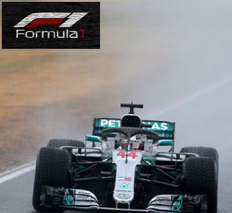 Hamilton_in_pole,_seconda_fila_Ferrari